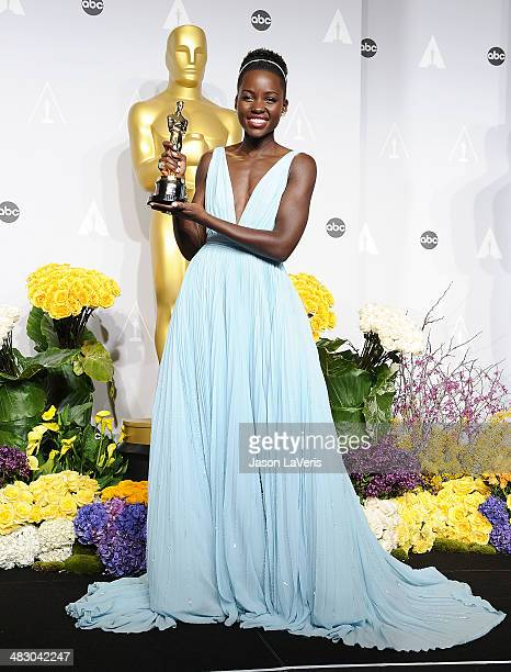 Actress Lupita Nyong'o poses in the press room at the 86th annual Academy Awards at Dolby Theatre on March 2 2014 in Hollywood California