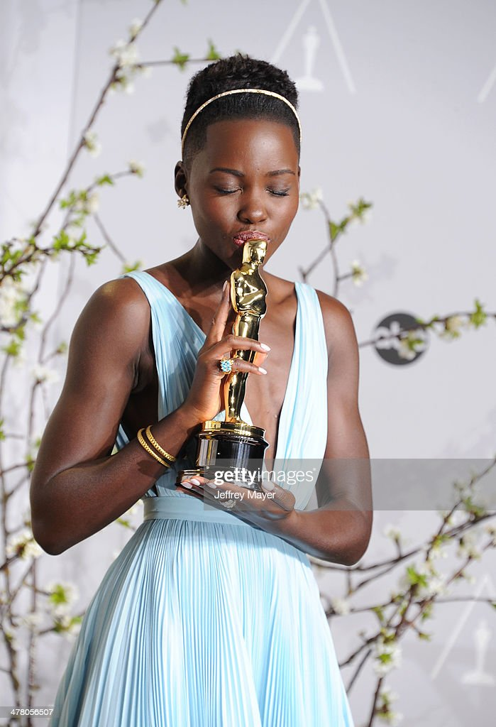 Actress <a gi-track='captionPersonalityLinkClicked' href=/galleries/search?phrase=Lupita+Nyong%27o&family=editorial&specificpeople=10961876 ng-click='$event.stopPropagation()'>Lupita Nyong'o</a> poses in the press room during the 86th Annual Academy Awards at Loews Hollywood Hotel on March 2, 2014 in Hollywood, California.