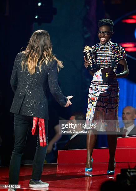 Actress Lupita Nyong'o presents the Best Transformation Award to actor Jared Leto for 'Dallas Buyers Club' onstage at the 2014 MTV Movie Awards at...