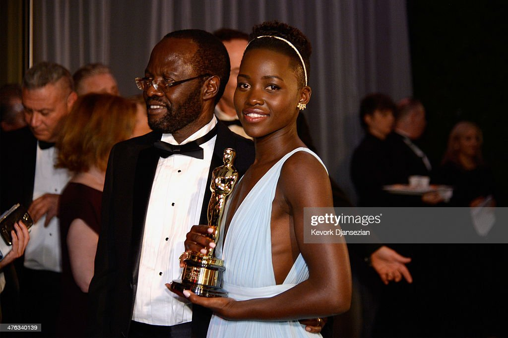 Actress <a gi-track='captionPersonalityLinkClicked' href=/galleries/search?phrase=Lupita+Nyong%27o&family=editorial&specificpeople=10961876 ng-click='$event.stopPropagation()'>Lupita Nyong'o</a> (R), winner of Best Performance by an Actress in a Supporting Role attends the Oscars Governors Ball at Hollywood & Highland Center on March 2, 2014 in Hollywood, California.