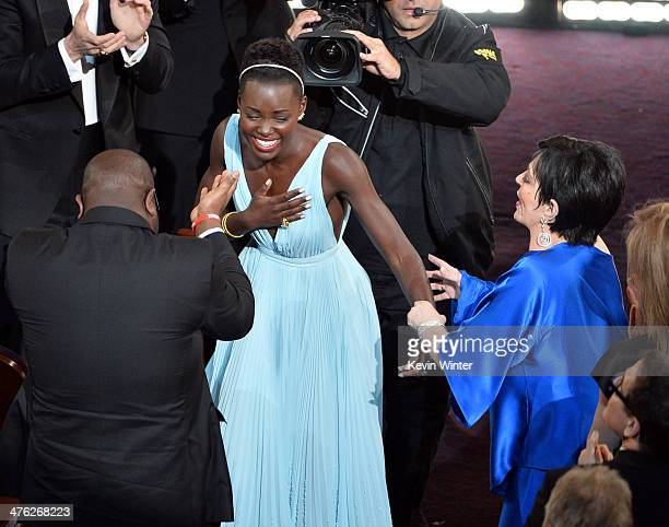 Actress Lupita Nyong'o winner of the Best Performance by an Actress in a Supporting Role award for '12 Years a Slave' with director Steve McQueen and...