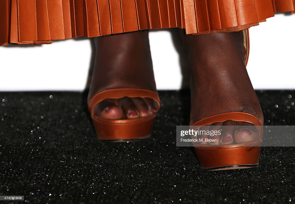 Actress Lupita Nyong'o (shoe detail), winner of the Outstanding Supporting Actress in a Motion Picture award for '12 Years a Slave,' poses in the press room during the 45th NAACP Image Awards presented by TV One at Pasadena Civic Auditorium on February 22, 2014 in Pasadena, California.