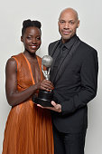 Actress Lupita Nyong'o winner of the Outstanding Supporting Actress in a Motion Picture award and screenwriter John Ridley winner of the Outstanding...