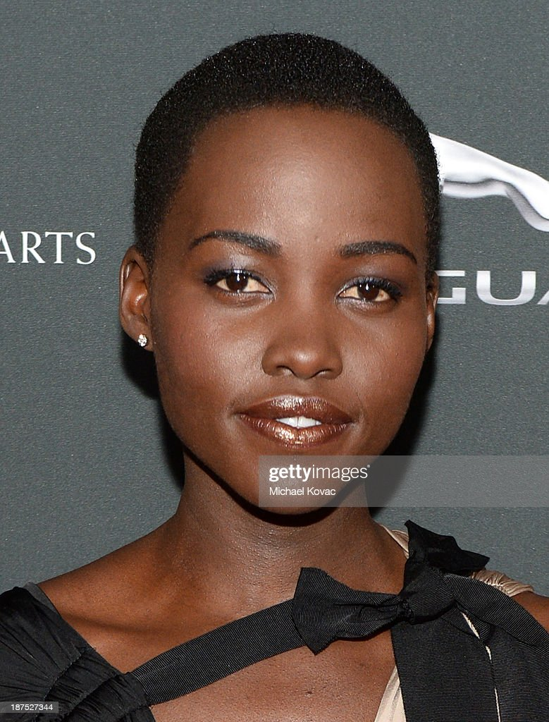 Actress Lupita Nyong'o with Stylebop.com attends the 2013 BAFTA LA Jaguar Britannia Awards presented by BBC America at The Beverly Hilton Hotel on November 9, 2013 in Beverly Hills, California.