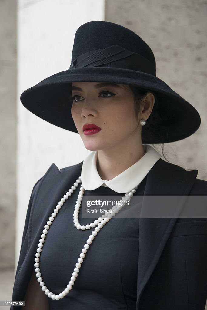 Actress Ly Nha Ky wears a Dice Kayak dress and jacket day 5 of Paris Haute Couture Fashion Week Autumn/Winter 2014 on July 10 2014 in Paris France