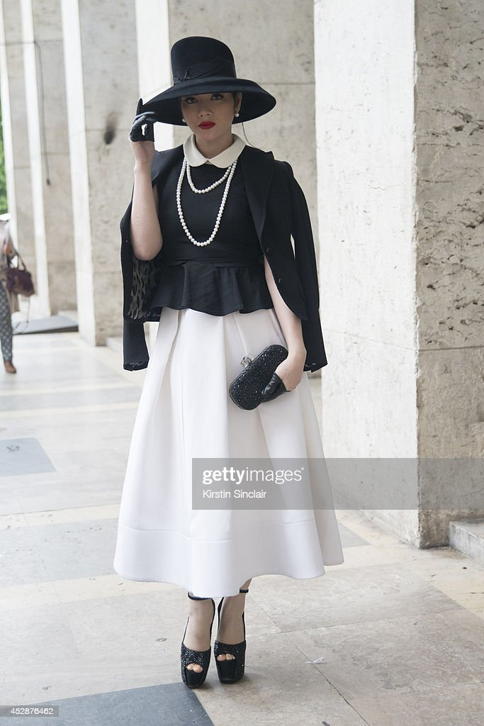 Actress Ly Nha Ky wears a Dice Kayak dress and jacket day 5 of Paris Haute Couture Fashion Week Autumn/Winter 2014, on July 10, 2014 in Paris, France.
