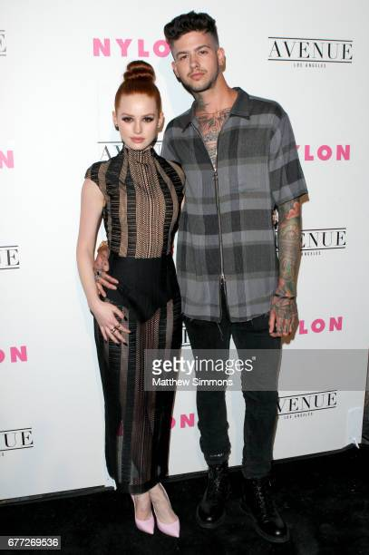 Actress Madelaine Petsch and rapper Travis Mills attend NYLON's Annual Young Hollywood May Issue Event at Avenue on May 2 2017 in Los Angeles...