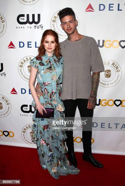 Actress Madelaine Petsch and recording artist Travis Mills attend the 14th Annual Brass Ring Awards Dinner at The Beverly Hilton Hotel on June 8 2017...