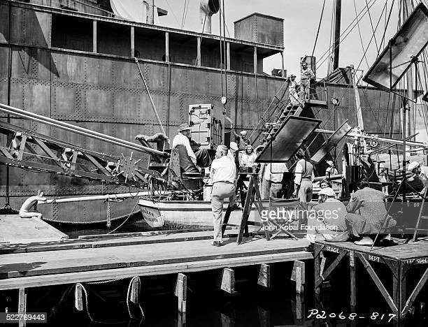 Actress Madeleine Carroll in a boat surrounded by camera crew on a film set with Paramount Pictures 1939