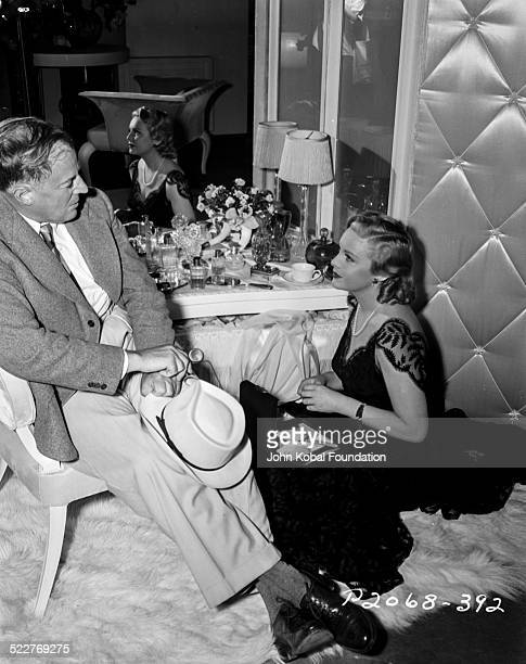 Actress Madeleine Carroll in a dressing room talking to an older man with Paramount Pictures 1935
