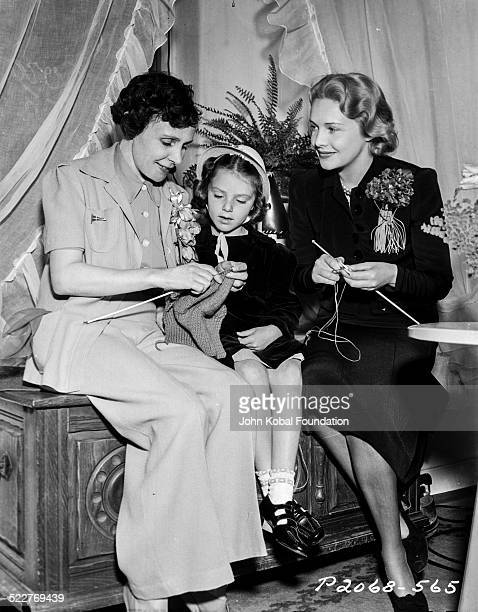 Actress Madeleine Carroll teaching a little girl how to knit with Paramount Pictures 1939