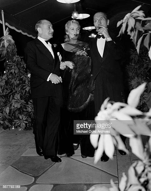 Actress Madeleine Carroll with Joseph M Schenck chairman of Fox and George Jomier a language coach attend an event in Los Angeles California