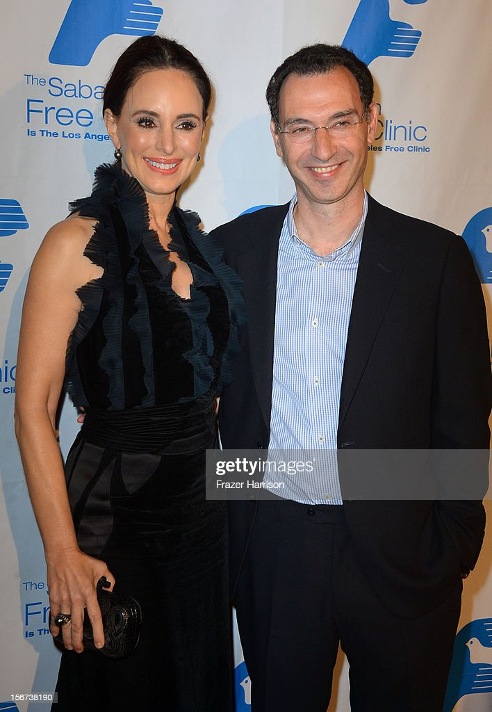 Actress Madeleine Stowe and honoree Paul Lee arrives at The Saban Free Clinic's Gala Honoring ABC Entertainment Group President Paul Lee and Bob Broder at The Beverly Hilton Hotel on November 19, 2012 in Beverly Hills, California.