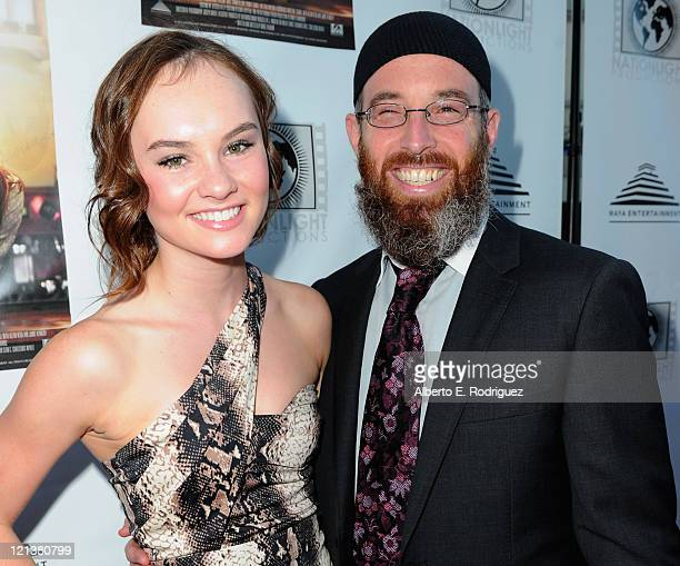 Actress Madeline Carroll and director Marc Erlbaum arrive to the premiere of Maya Entertainment's 'Cafe' on August 18 2011 in Los Angeles California