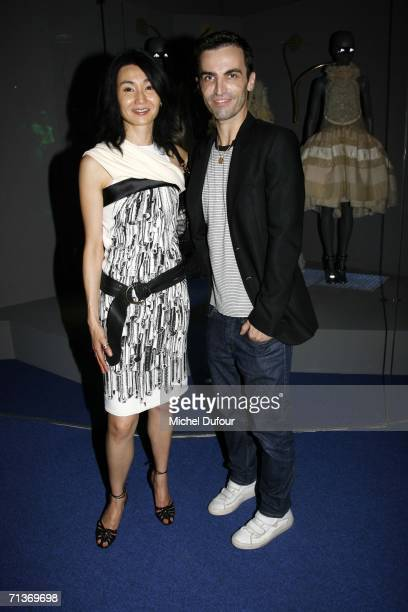 Actress Maggie Cheung attends and designer Nicolas Ghesquiere attend a retrospective of the work of Cristobal Balenciaga at the Museum of Fashion and...