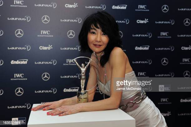 Actress Maggie Cheung poses with the trophy at the 2013 Laureus World Sports Awards at the Theatro Municipal Do Rio de Janeiro on March 11 2013 in...