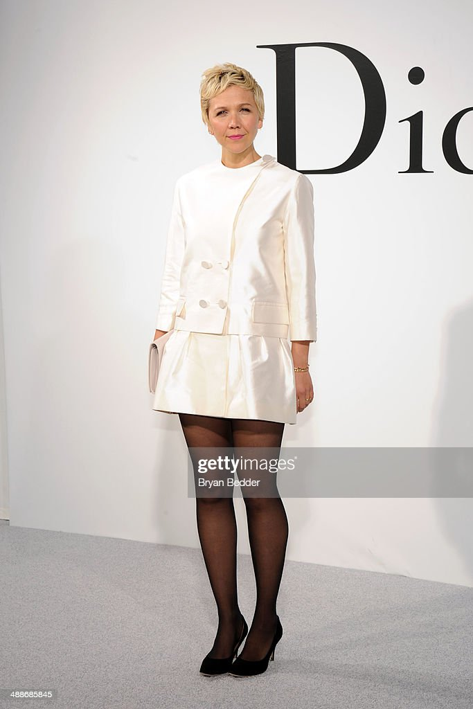 Actress <a gi-track='captionPersonalityLinkClicked' href=/galleries/search?phrase=Maggie+Gyllenhaal&family=editorial&specificpeople=202607 ng-click='$event.stopPropagation()'>Maggie Gyllenhaal</a> attends the Christian Dior Cruise 2015 Show on May 7, 2014 in Brooklyn, New York City.