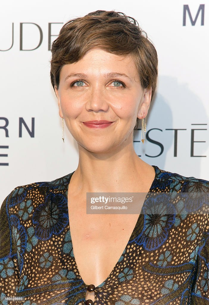 Actress <a gi-track='captionPersonalityLinkClicked' href=/galleries/search?phrase=Maggie+Gyllenhaal&family=editorial&specificpeople=202607 ng-click='$event.stopPropagation()'>Maggie Gyllenhaal</a> attends the Estee Lauder 'Modern Muse' Fragrance Launch at Guggenheim Museum on September 12, 2013 in New York City.