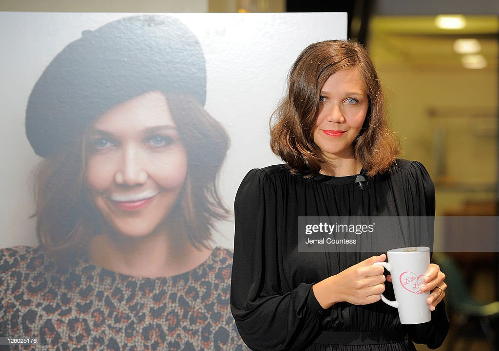 Actress Maggie Gyllenhaal poses for a photo a she unveils her 'got milk' ad at City Bakery on September 22 2011 in New York City
