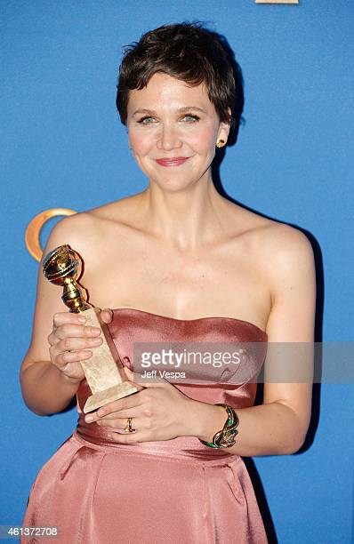 Actress Maggie Gyllenhaal poses in the press room during the 72nd Annual Golden Globe Awards at The Beverly Hilton Hotel on January 11 2015 in...