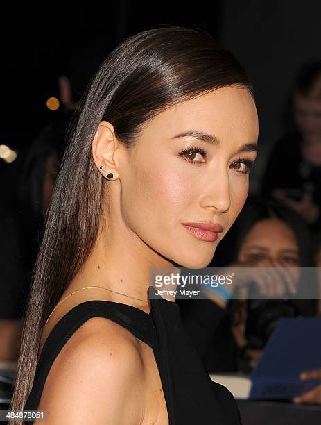 Actress Maggie Q arrives at the Los Angeles premiere of 'Divergent' at Regency Bruin Theatre on March 18 2014 in Los Angeles California