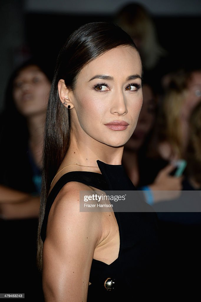 Actress Maggie Q arrives at the premiere of Summit Entertainment's 'Divergent' at the Regency Bruin Theatre on March 18, 2014 in Los Angeles, California.