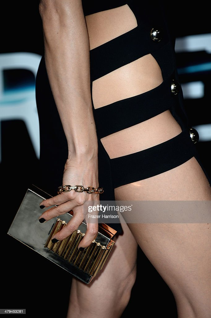 Actress Maggie Q (fashion detail) arrives at the premiere of Summit Entertainment's 'Divergent' at the Regency Bruin Theatre on March 18, 2014 in Los Angeles, California.