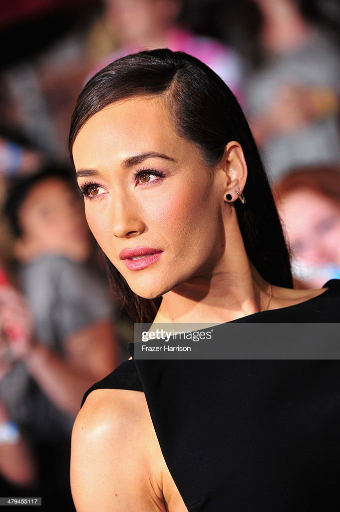 Actress <a gi-track='captionPersonalityLinkClicked' href=/galleries/search?phrase=Maggie+Q&family=editorial&specificpeople=555127 ng-click='$event.stopPropagation()'>Maggie Q</a> arrives at the premiere of Summit Entertainment's 'Divergent' at the Regency Bruin Theatre on March 18, 2014 in Los Angeles, California.