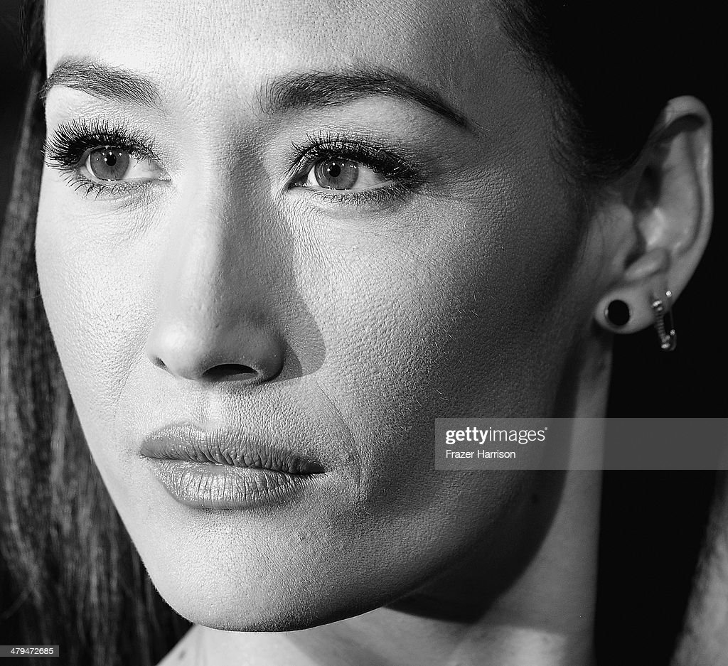 . Actress <a gi-track='captionPersonalityLinkClicked' href=/galleries/search?phrase=Maggie+Q&family=editorial&specificpeople=555127 ng-click='$event.stopPropagation()'>Maggie Q</a> arrives at the premiere Of Summit Entertainment's 'Divergent' at Regency Bruin Theatre on March 18, 2014 in Los Angeles, California.
