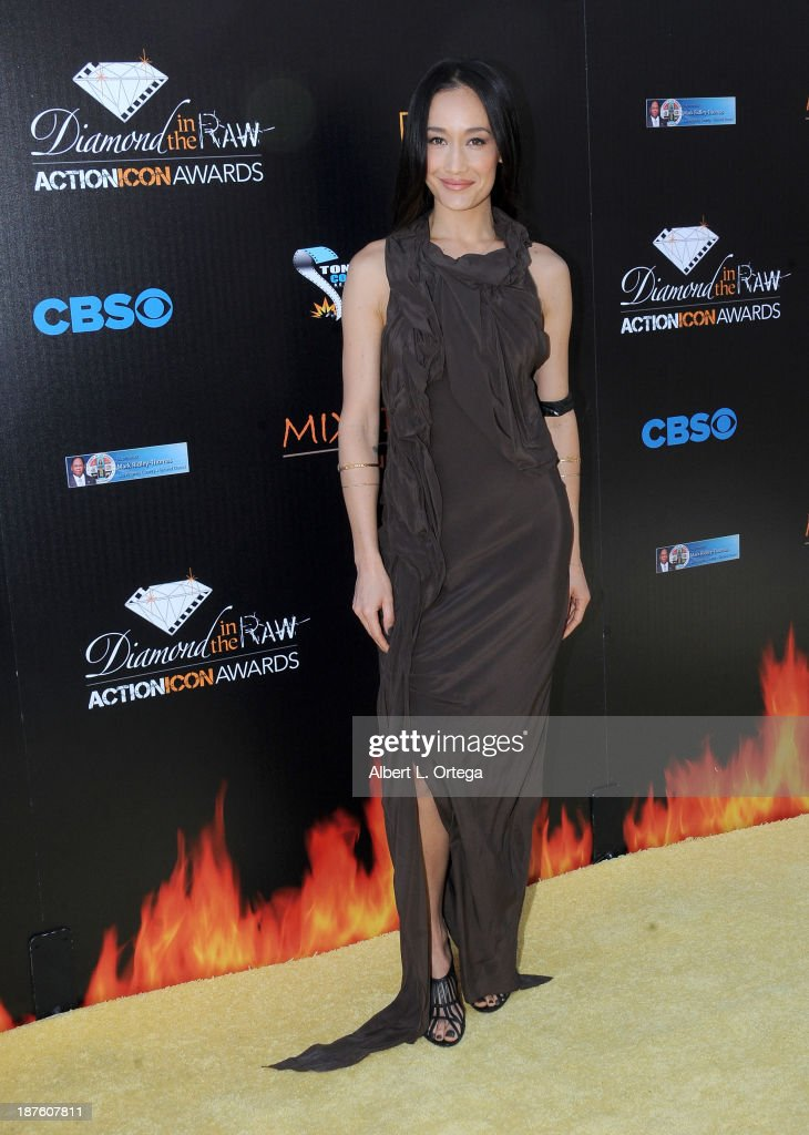 Actress <a gi-track='captionPersonalityLinkClicked' href=/galleries/search?phrase=Maggie+Q&family=editorial&specificpeople=555127 ng-click='$event.stopPropagation()'>Maggie Q</a> arrives for the 6th Annual Diamond In The RAW -Action Icon Awards held at Skirball Cultural Center on November 10, 2013 in Los Angeles, California.