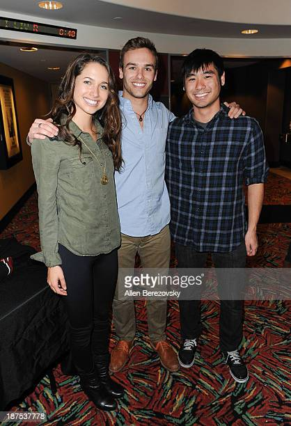 Actress Maiara Walsh and actor Ross Wyngaarden pose for a picture with a fan at 'The Starving Games' Hunger Games Spoof meet and greet at AMC Orange...