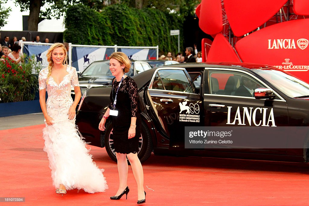 Actress Maika Monroe (L) attend the 'At Any Price' premiere during the 69th Venice Film Festival at the Palazzo del Cinema on August 31, 2012 in Venice, Italy.