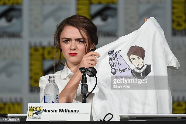Actress Maisie Williams holds up a Tshirt with her image and the words 'Plays Well With Others' on it that she received at the TV Guide Magazine Fan...