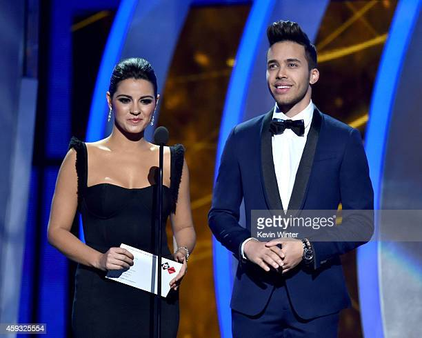 Actress Maite Perroni and recording artist Prince Royce speak onstage during the 15th annual Latin GRAMMY Awards at the MGM Grand Garden Arena on...