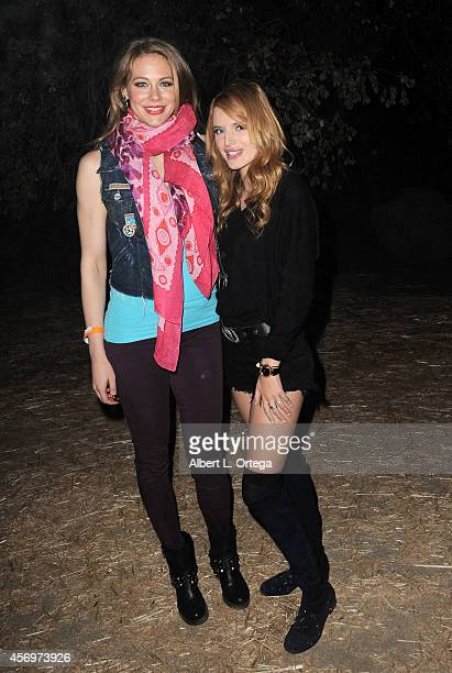 Actress Maitland Ward and actress Bella Thorne arrive for the Los Angeles Haunted Hayride held at Griffith Park on October 9 2014 in Los Angeles...