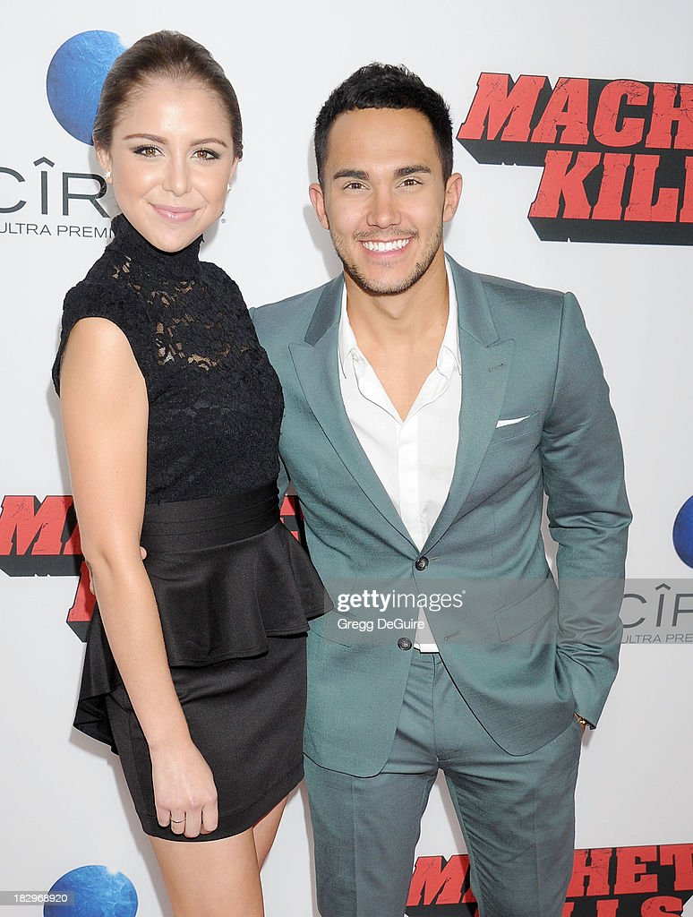Actress Makenzie Vega and actor/singer Carlos Pena Jr. arrive at the Los Angeles premiere of 'Machete Kills' at Regal Cinemas L.A. Live on October 2, 2013 in Los Angeles, California.