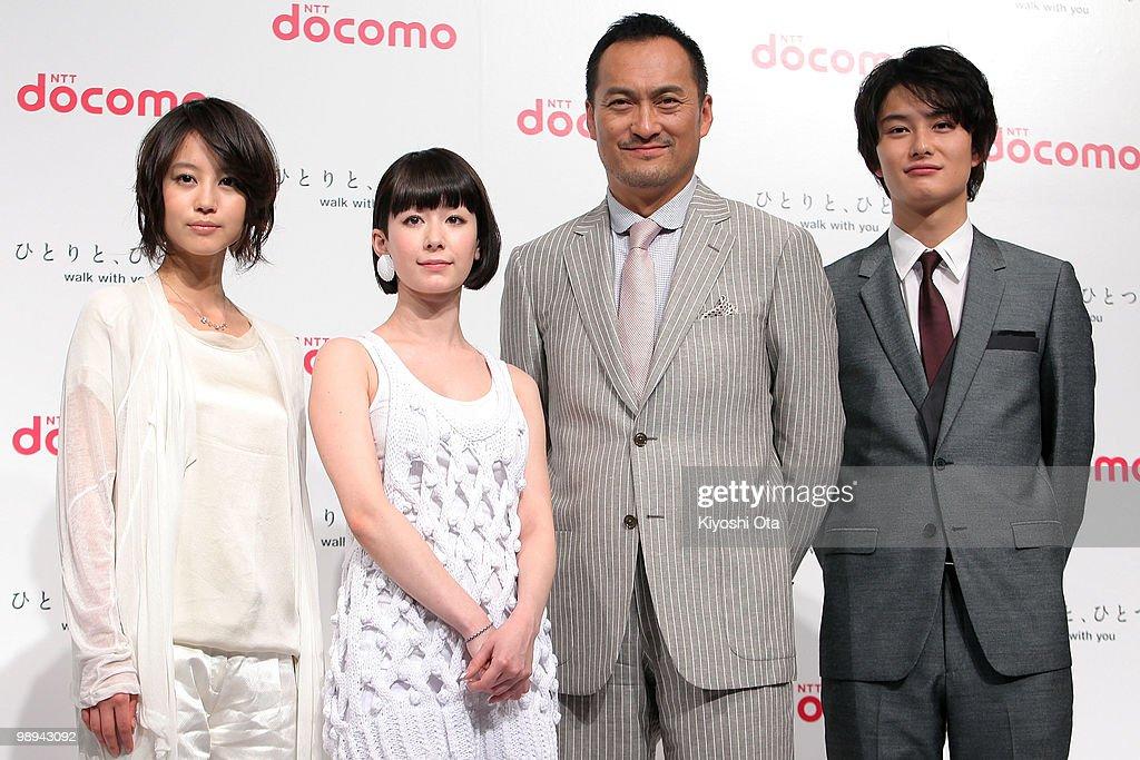 Actress Maki Horikita singer Kaela Kimura actors Ken Watanabe and Masaki Okada pose during the NTT DoCoMo Inc's new TV commercial press conference at...