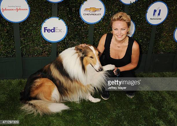 Actress Malin Akerman and Lassie attend the Safe Kids Day presented by Nationwide at The Lot on April 26 2015 in West Hollywood California