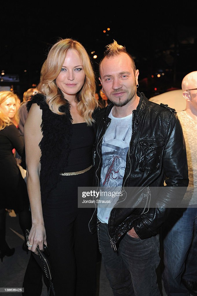 Actress <a gi-track='captionPersonalityLinkClicked' href=/galleries/search?phrase=Malin+Akerman&family=editorial&specificpeople=598245 ng-click='$event.stopPropagation()'>Malin Akerman</a> and Roberto Zincone attend Tesla Worldwide Debut of Model X on February 9, 2012 in Los Angeles, California.