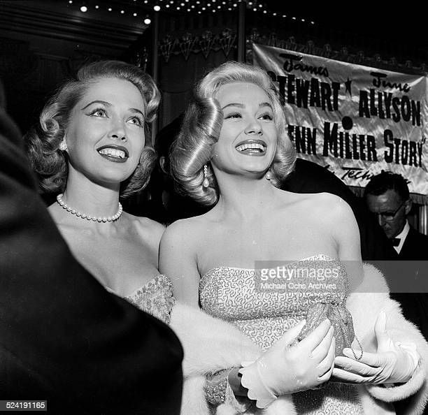 Actress Mamie Van Doren and Sara Shane attend the movie premiere of 'The Glenn Miller Story' in Los AngelesCA