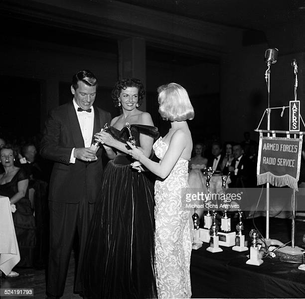 Actress Mamie Van Doren hands out the trophy with Jane Russell during the International Press Club Awards in Los AngelesCA
