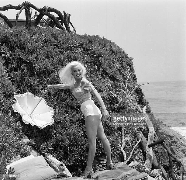 Actress Mamie Van Doren poses at the beach in Los AngelesCA