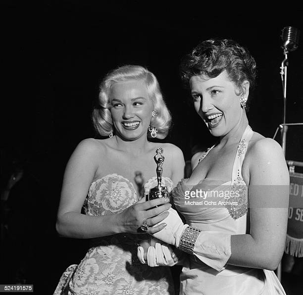 Actress Mamie Van Doren poses with trophies and winner during the International Press Club Awards in Los AngelesCA