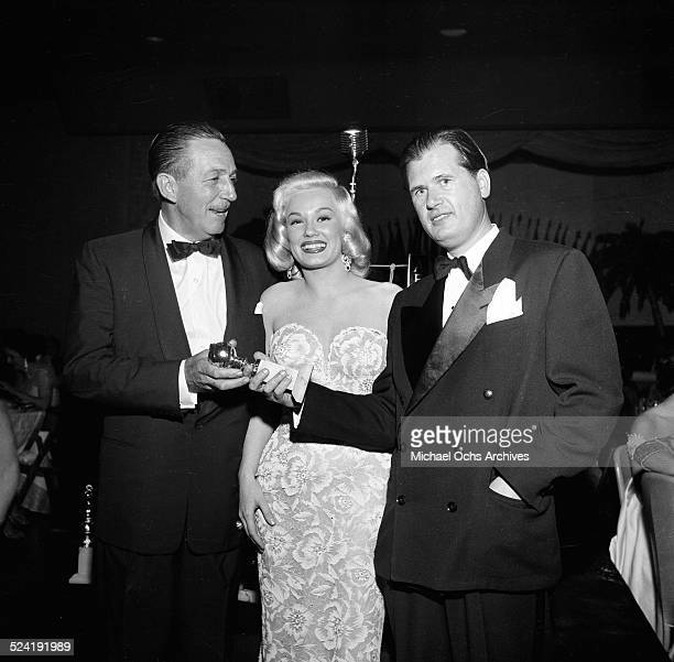 Actress Mamie Van Doren poses with trophy and winner Walt Disney during the International Press Club Awards in Los AngelesCA