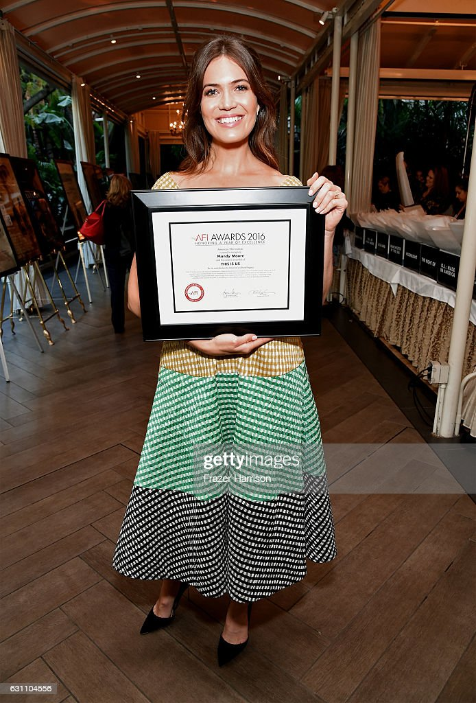 actress-mandy-moore-poses-with-award-attend-the-17th-annual-afi-at-picture-id631104556