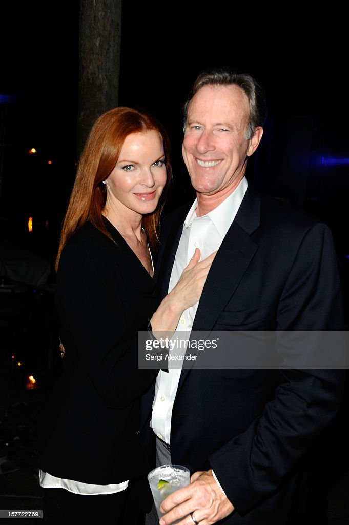 Actress <a gi-track='captionPersonalityLinkClicked' href=/galleries/search?phrase=Marcia+Cross&family=editorial&specificpeople=202844 ng-click='$event.stopPropagation()'>Marcia Cross</a> (L) and husband <a gi-track='captionPersonalityLinkClicked' href=/galleries/search?phrase=Tom+Mahoney&family=editorial&specificpeople=2138138 ng-click='$event.stopPropagation()'>Tom Mahoney</a> attend The Hole Gallery concert sponsored by Playboy and hosted by Delano at Delano Hotel on December 5, 2012 in Miami, Florida.