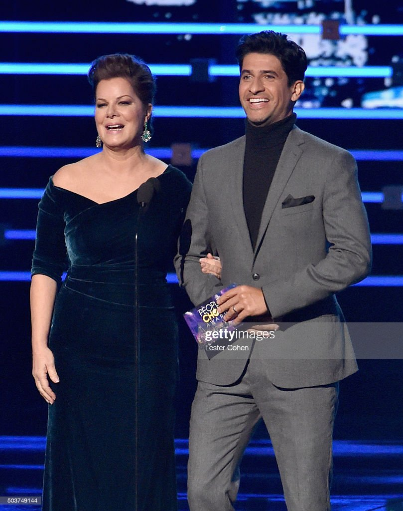 Actress Marcia Gay Harden (L) and actor Raza Jeffrey appear onstage during the People's Choice Awards 2016 at Microsoft Theater on January 6, 2016 in Los Angeles, California.