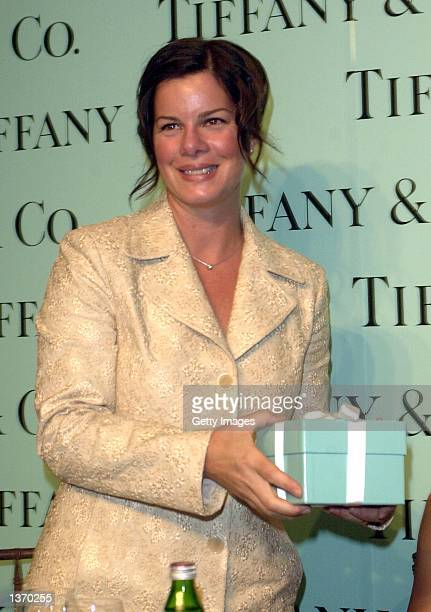 Actress Marcia Gay Harden holds a gift box containing a Tiffany Mark watch presented to her by Tiffany Co President Michael Kowalski in New York on...