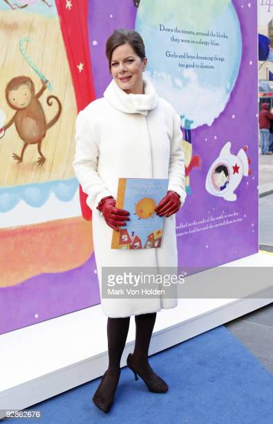 Actress Marcia Gay Harden poses in front of The Big Book of Dreams in Rockefeller Center on November 6 2009 in New York City