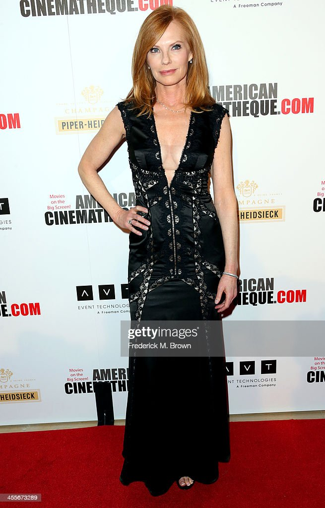 Actress <a gi-track='captionPersonalityLinkClicked' href=/galleries/search?phrase=Marg+Helgenberger&family=editorial&specificpeople=201493 ng-click='$event.stopPropagation()'>Marg Helgenberger</a> arrives at the 27th American Cinematheque Award honoring Jerry Bruckheimer at The Beverly Hilton Hotel on December 12, 2013 in Beverly Hills, California.